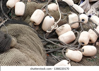 Old fishing nets with weathered buoys