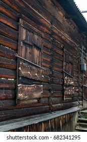 Old fishing processing plant wooden structures. Weathered by Siberian climate wooden buildings.