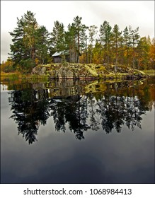 An old fishing shed on a rocky islet