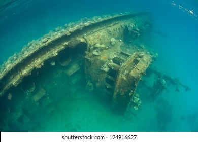 An old fishing vessel now rests on the bottom of Palau's inner lagoon where the ship is serving as an artificial reef, attracting corals and fish.