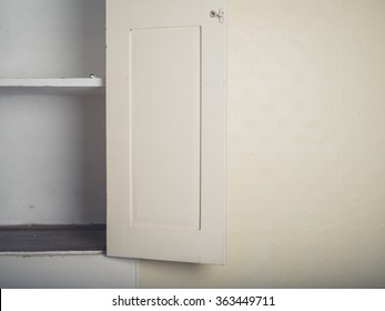 An old fitted cupboard in a house