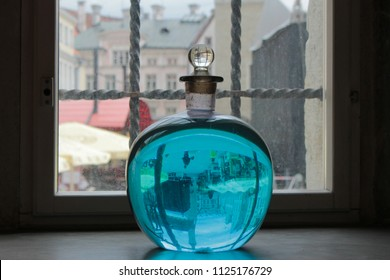 Old flask with blue liquid reflected with light from the window in an old pharmacy in Tallinn, Estonia