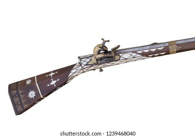 Old flintlock rifle. Musket decorated with bone and brass.