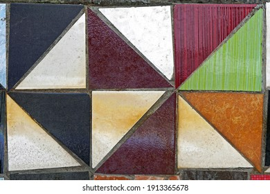 Old floor tiles made from triangular pieces