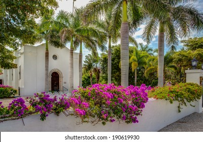 Old Florida Spanish styled church surrounded by royal palms