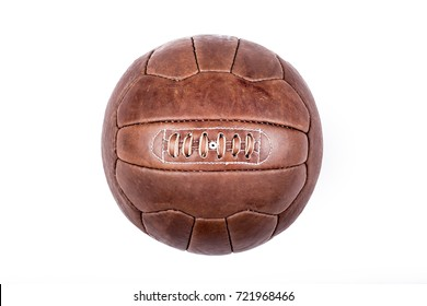 Old football leather ball on a white background