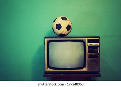 An old football on a retro TV, vintage style