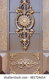 Old forged decorative gates decorated by golden ornament.