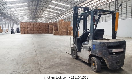 the old forklift in lumber warehouse