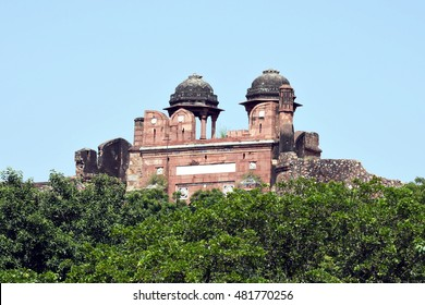Old Fort, New Delhi. Old Fort, also known as Purana Qila, is the oldest historical site in New Delhi. Here, Humayun Darwaza, or the South Gate facade, partly hidden by vegetation, is shown.