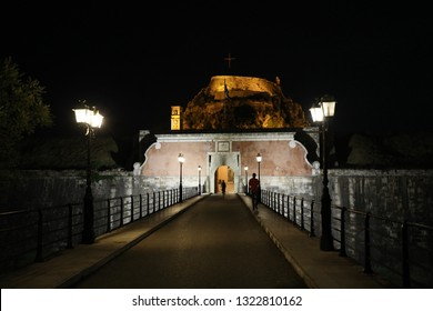 The Old Fortress of Corfu with its bridge by night, Kerkyra, Corfu Island, Greece, Europe The Old Fortress of Corfu is a Venetian fortress in the city of Corfu. The fortress covers a promontory.