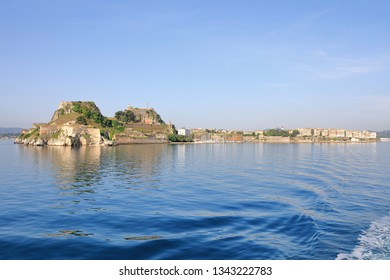 The Old Fortress of Corfu with shoreline of Kerkyra seen from a boat, Corfu Island, Greece, Europe The Old Fortress of Corfu is a Venetian fortress in the city of Corfu.