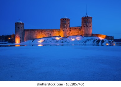 The old fortress of Olavinlinna (Olafsborg) is close-up in March twilight. Savonlinna, Finland