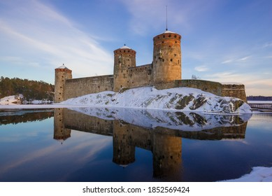 At the old fortress of Olavinlinna (Olafsborg) in the March evening. Savonlinna, Finland