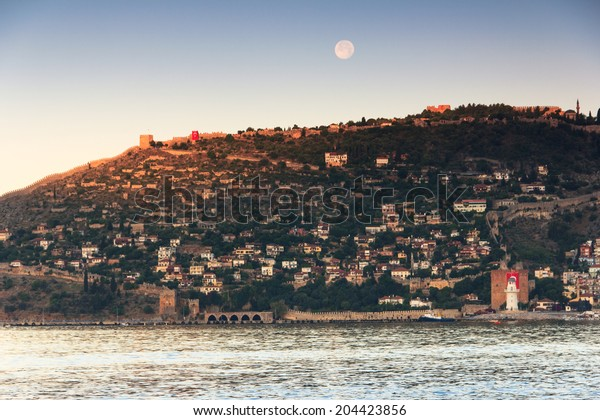 Old fortress on the sea and the moon. Mediterranean sea,  Alanya, Turkey.