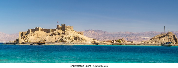 Old fortress of sultan Salah El Din in Taba - ancient landmarks of an arabic culture on Sinai Peninsula, Egypt. Panorama of medieval Citadel of Saladin on the Pharaoh's Island in the Gulf of Aqaba.