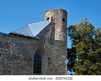 Old fortress tower against blue sky. High quality photo