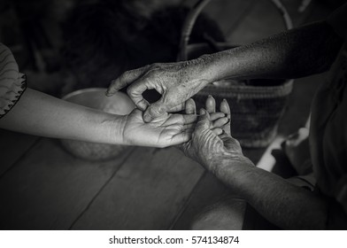 Old Fortune Teller are Telling Something  in the Future by the Shape of the Hands and Lines in the Palms