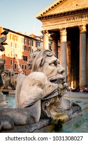 Old fountain annd the ancient Pantheon temple in Rome at sunset