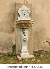 """Old fountain at Dungeness, Cumberland Island, Georgia.  Not sure what its real name is, but I heard the face on top referred to as the """"green man""""."""