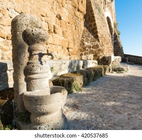 old fountain at the entrance to otricoli