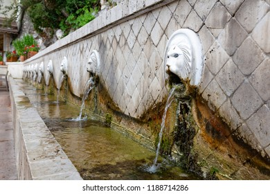 Old fountain with lions heads in Spili, Crete, Greece