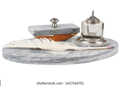 Old fountain pen with rocking ink blotter with silver and glass inkwell isolated on white background