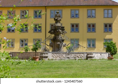 old fountain and plants at historical building facade at summer sunshine day in stuttgart south germany