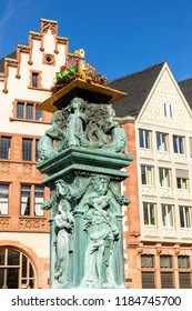 old fountain at roemer with an artifical stoch nest and allegory figures from the 19th century