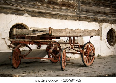 an old four-wheeled horse-drawn carriage stays abandoned. old cart carriage or horse wagon without the horse.