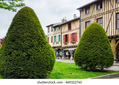 Old framework houses at main square of medieval village Mirepoix in southern France