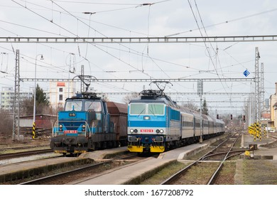 Old freight electric locomotive and passenger train in Nymburk, Czech Republic