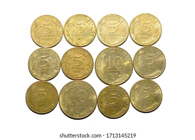 Old French 5 and 10 centime coins on a plain white background