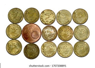 Old French 5 centime coins with a new Euro 5 centime one on a plain white background