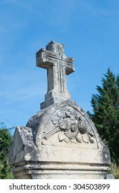 Old French grave with cross