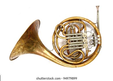 old french horn isolated on the white background