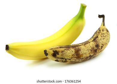Old and fresh banana on white background.