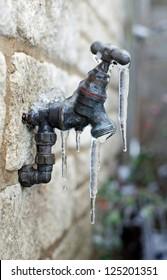 Old frozen water tap