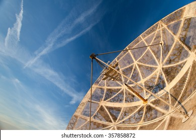 old functional radio telescope in the sunset