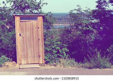 Old funny wooden toilet. Toilet in the household. Outside washroom for visitors or tourists and travelers at a forest. Close up