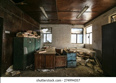 Old furniture and books in abandoned factory building