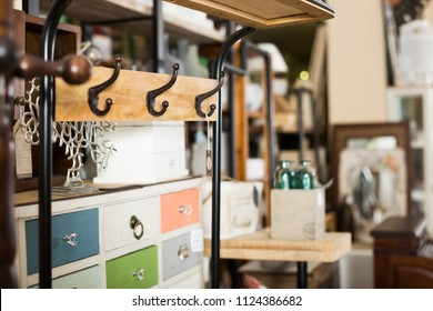 Old furniture offered for sale in secondhand shop