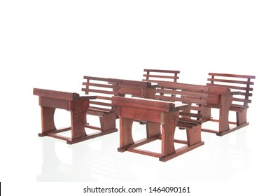 Old furniture from vintage classroom isolated over white background