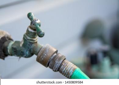 old garden hose spigot valve.