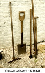 Old garden tool leaning against a wall