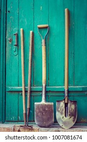Old garden tools over wooden door.