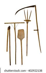old garden tools shovel pitchfork rake scythe isolated on white background