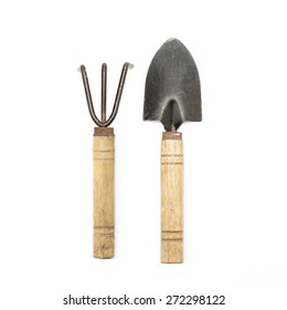 old gardening tools spade and rake isolated on white background