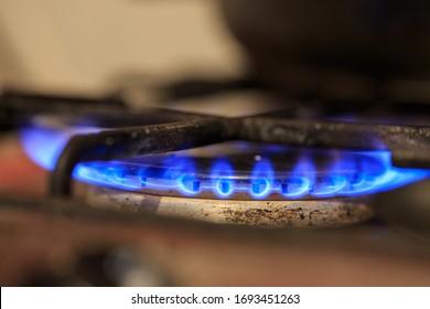 Old gas burner, blue gas flame