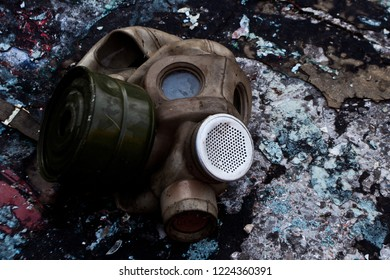 The old gas mask lies on a destroyed concrete floor, a symbol of the horrors of nuclear war and chemical weapons and doom.